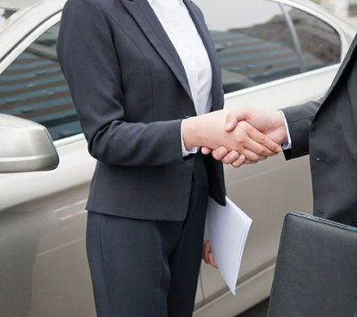 A Car Title Loan Specialist and a Customer Shaking Hands