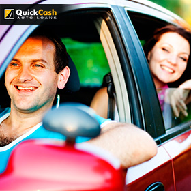 Happy Family Driving Their Car After Receiving An Auto Title Loan